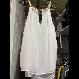 New. White with gold detail top.